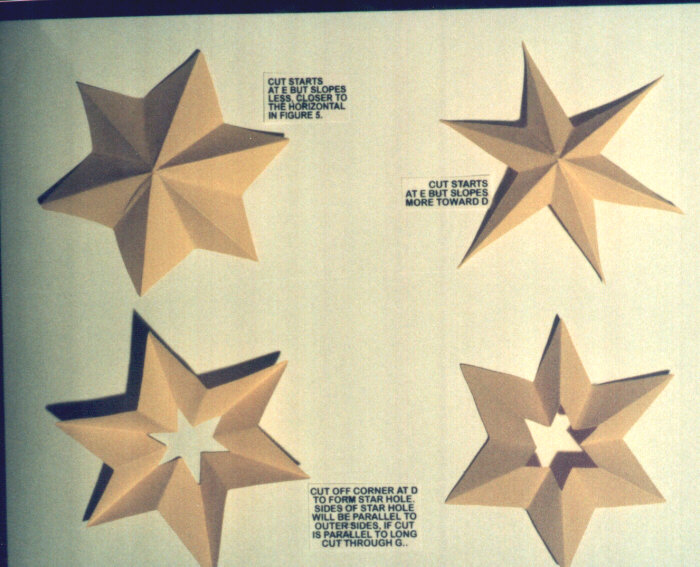 Picture of finished paper 6 point stars. Wide, thin, or with star holes.